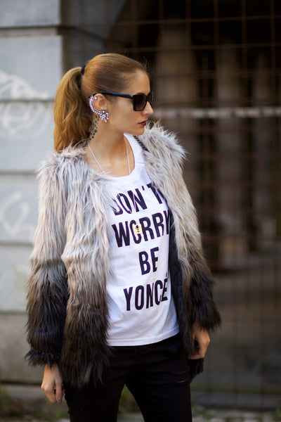 Ruxandra in a printed t-shirt and gradient fur coat