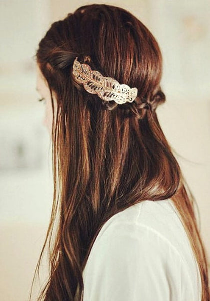 Left side view of model wearing large leaf gold hair slide