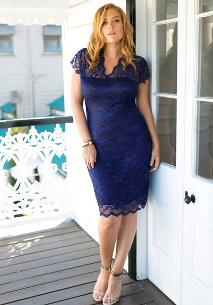 Model in a navy floral lace sheath dress and stilettos