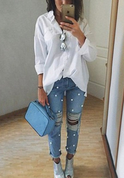 Model_wearing_faux_pearl_distressed_straight-leg_jeans_with_white_shirt