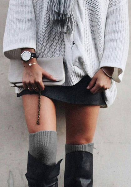 model_in_grey_knee-length_knit_leg_warmers
