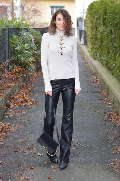 Isabella in leather pants and knitted top