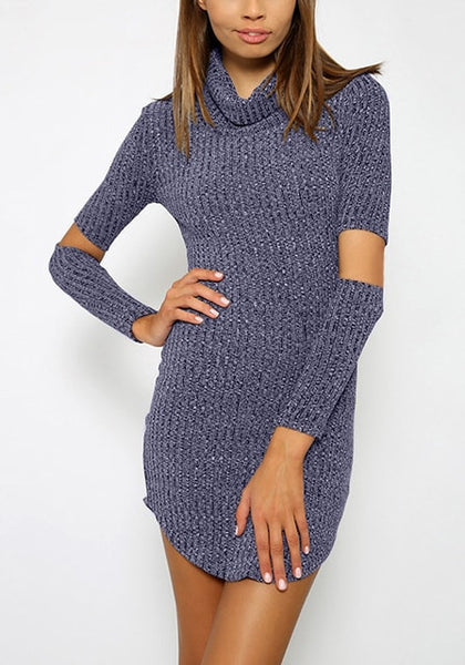 Sultry woman in blue melange turtleneck tunic