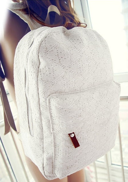 White lace backpack on a girls back