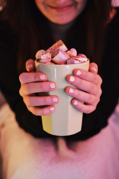 girl drinking hot chocolate with marshmallows