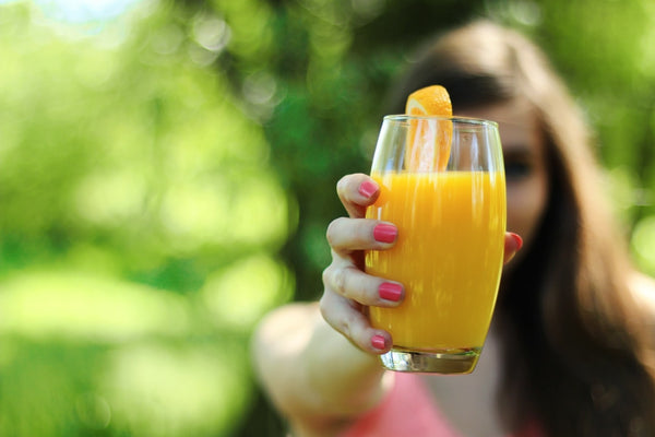 Girl with a glass of orange juice