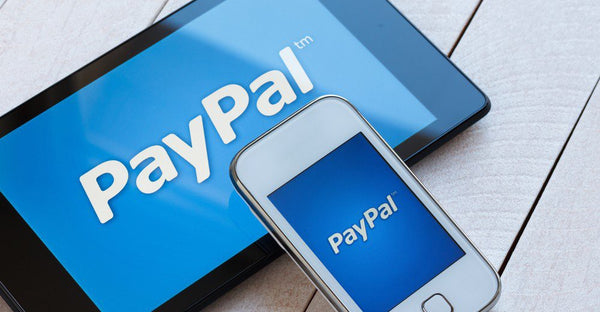 Paypal text on tablet and smartphone