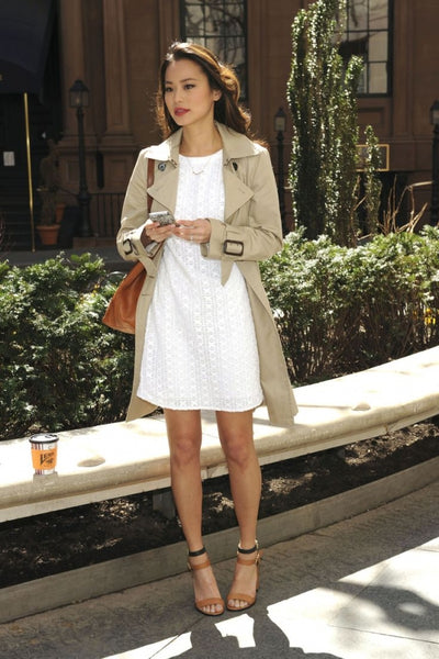 Jamie Chung in a white dress and beige coat