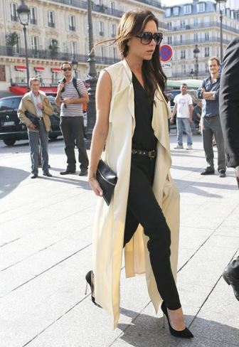 Victoria Beckham in a sleeveless camel trench coat