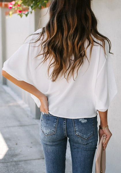 Back view of model wearing white cowl neckline batwing sleeves loose chiffon top