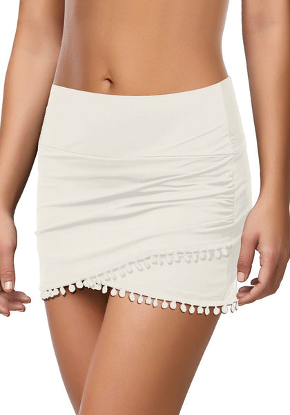 Model poses wearing white tulip hem tassels mid-waist ruched swim skirt