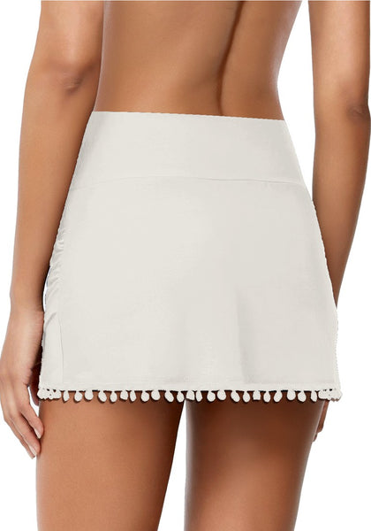 Back view of model wearing white tulip hem tassels mid-waist ruched swim skirt