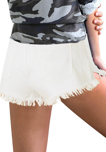 Model wearing white frayed raw he distressed high-waist denim shorts