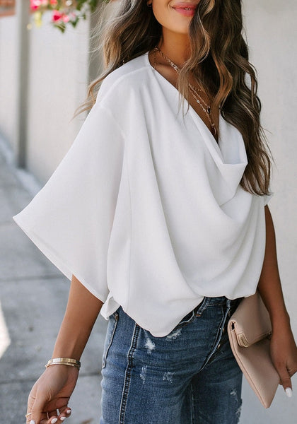 Angled shot of model wearing white cowl neckline batwing sleeves loose chiffon top