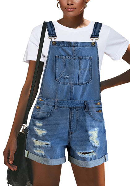 Front view of model wearing medium blue roll-over hem ripped denim shorts overall