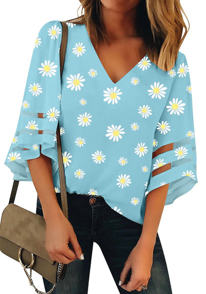 Front view of model wearing sky blue daisy-print 3/4 bell mesh panel sleeves V-neckline top