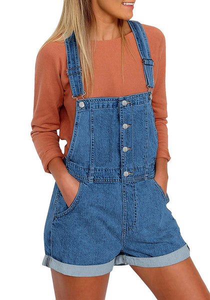 Front view of model wearing deep blue button-front rolled hem shorts denim overall