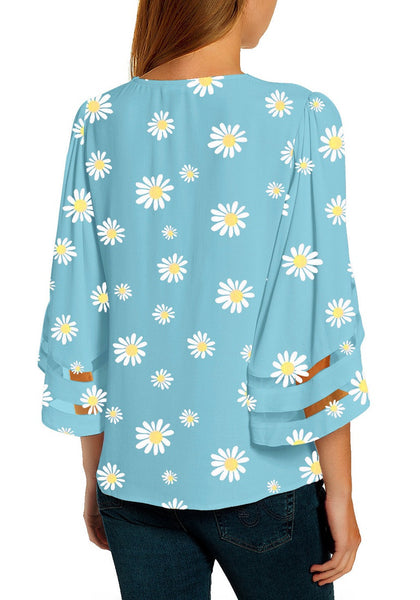 Back view of model wearing sky blue daisy-print 3/4 bell mesh panel sleeves V-neckline top