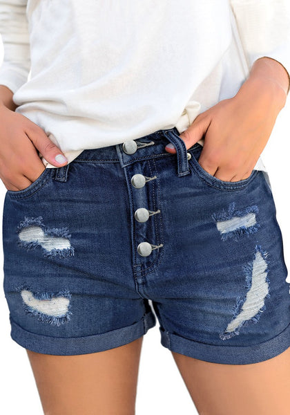 Front view of model wearing deep blue roll-over hem button-up ripped denim shorts