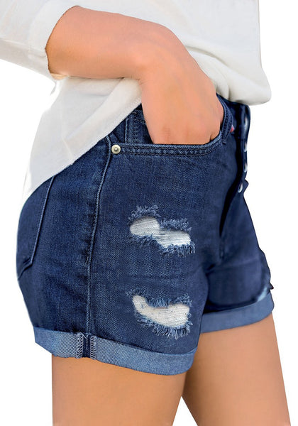 Side view of model wearing deep blue roll-over hem button-up ripped denim shorts