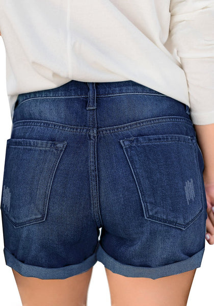 Back view of model wearing deep blue roll-over hem button-up ripped denim shorts