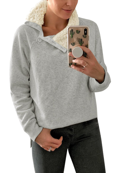 Mirror selfie of woman in light grey split cowl collar long sleeves pullover top