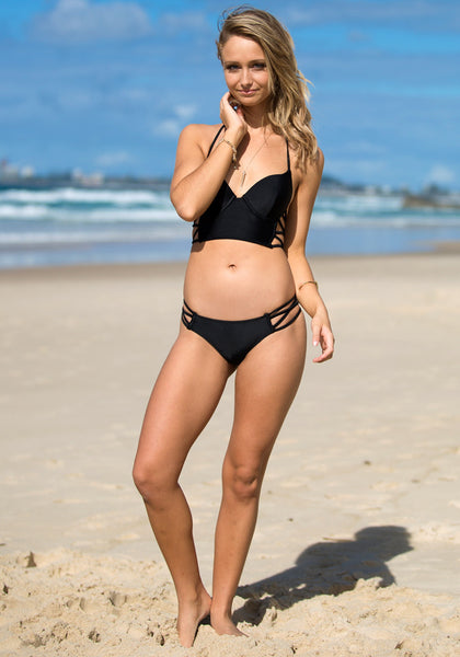 Full front view of model in cutout side bikini set - black