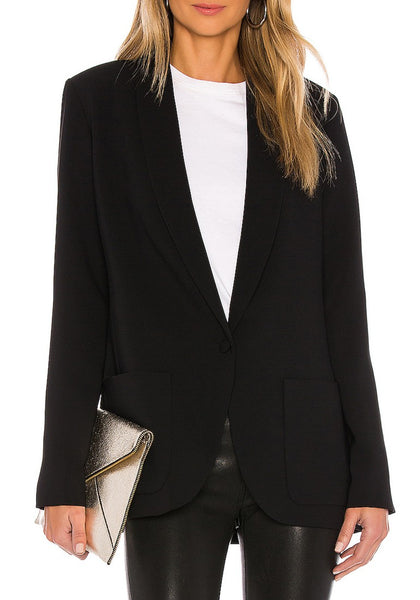 Front view of model wearing black lapel patch pockets boyfriend blazer