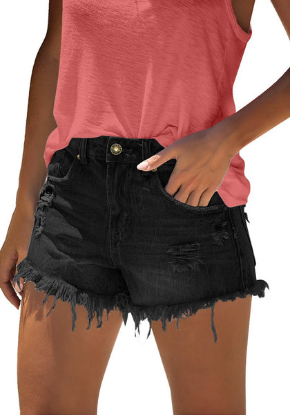 Angled shot of model wearing black frayed raw hem ripped denim shorts