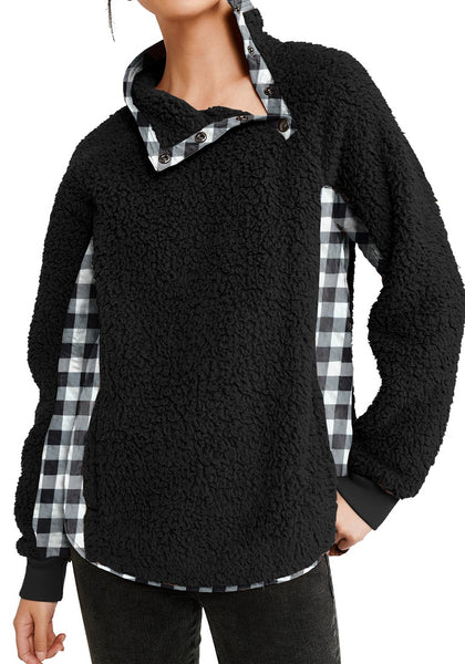 Front view of model wearing black split cowl neck plaid fleece sweater top