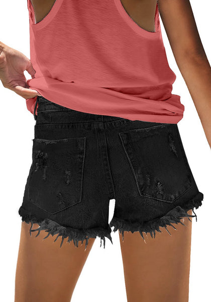 Back view of model wearing black frayed raw hem ripped denim shorts