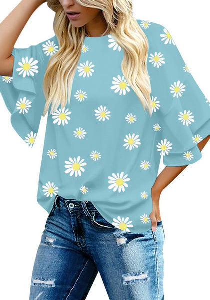 Model poses wearing light blue trumpet sleeves keyhole-back daisy printed blouse