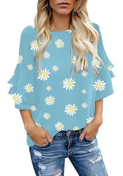 Model wearing light blue trumpet sleeves keyhole-back daisy printed blouse
