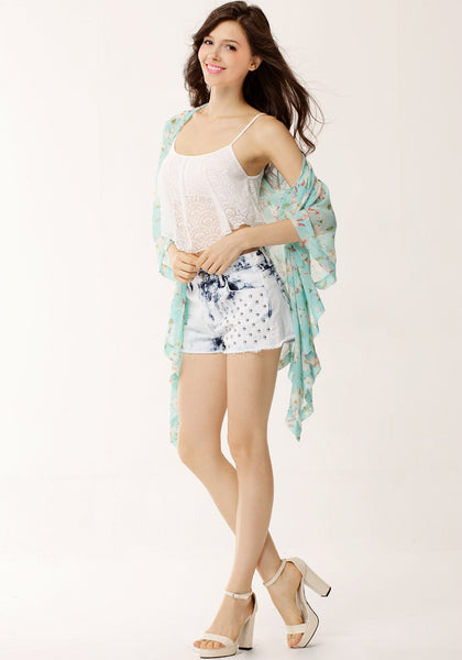 Full view of model wearing lace overlay crop top, kimono and denim shorts