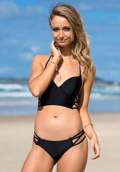 Blonde model wearing cutout side bikini set - black
