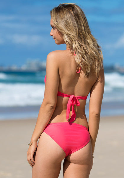 Back view of model in ruffles tie up bikini set - coral