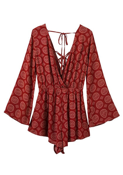 3D image of front of maroon lace-up trumpet sleeves romper