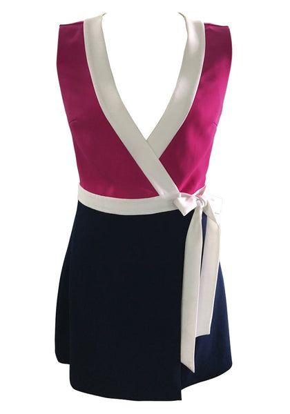 3D image shot of pink and navy sleeveless wrap-style dress
