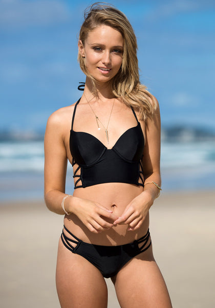 Frontal view of model in cutout side bikini set - black