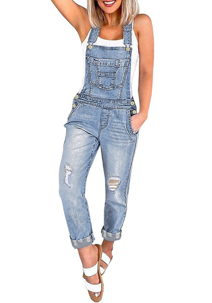 Front view of model wearing light blue raw hem distressed cropped denim overalls