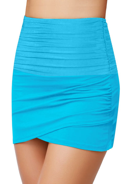 Angled shot of model wearing sky blue high-waist tulip hem ruched swim skirt