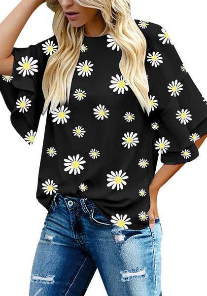 Model poses wearing black trumpet sleeves keyhole-back daisy printed blouse