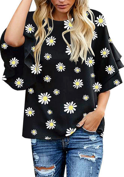 Front view of model wearing black trumpet sleeves keyhole-back daisy printed blouse