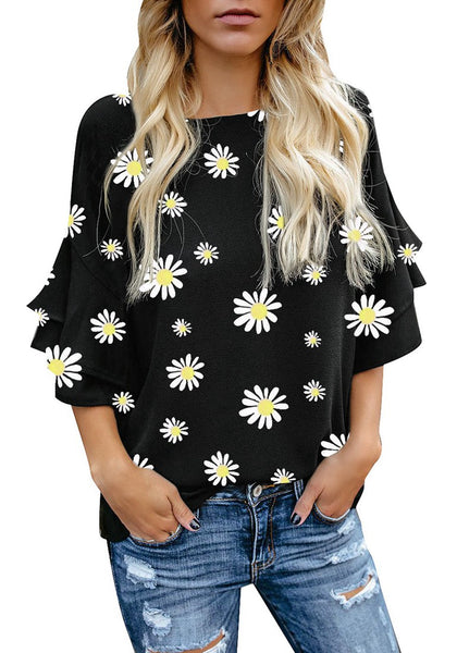 Model wearing black trumpet sleeves keyhole-back daisy printed blouse