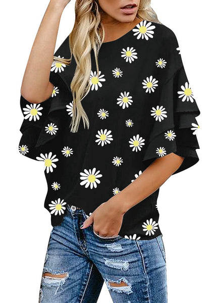 Angled shot of model wearing black trumpet sleeves keyhole-back daisy printed blouse
