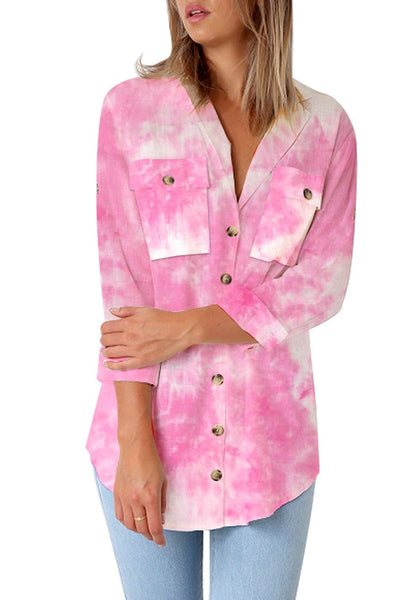 Model poses wearing pink tie-dye long cuffed sleeves lapel button-up blouse