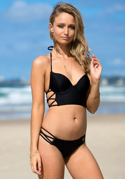 Sexy pose of model in cutout side bikini set - black