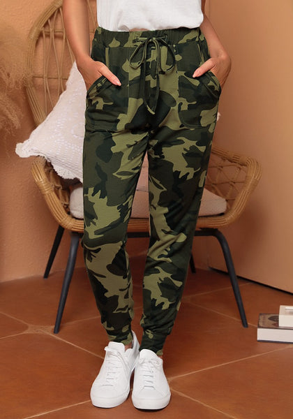 Front view of model wearing army green camouflage drawstring elastic waist jogger pants