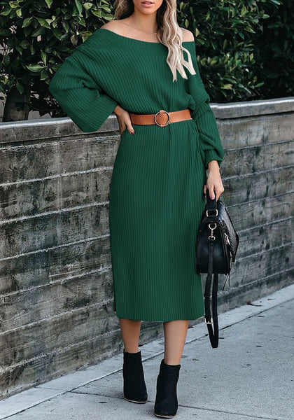 Model poses wearing dark green loose lantern sleeves V-back knit midi dress