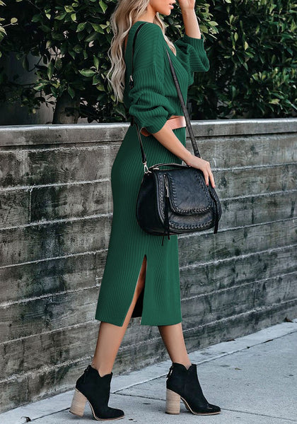 Side view of model wearing dark green loose lantern sleeves V-back knit midi dress